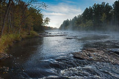 Mist Rises over River on Autumn Morning Royalty Free Stock Photography