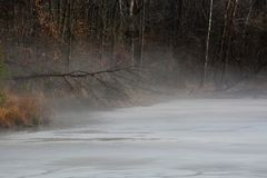 Mist on ice covered pond Royalty Free Stock Image