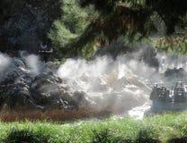 Misty river rapids ride. Mist rising above river rapids ride at amusement park Stock Photo