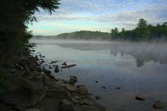 Mist rising from a lake in the wilderness Stock Image