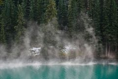Mist rising from mountain lake Stock Image