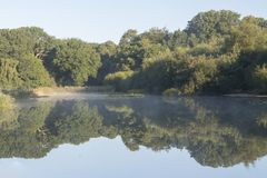 Mist rising on the Ornamental Pond Southampton Common royalty free stock images