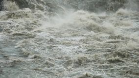 Mist rising from whitewater rapids. Mist rising from water cascading down whitewater rapids in Iceland stock video footage