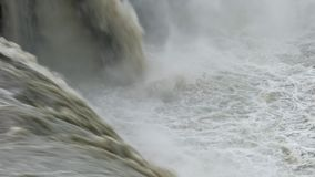 Mist rising from whitewater rapids. Mist rising from water rushing down a waterfall and rapids in Iceland stock footage