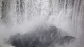 Mist and rocks at niagara falls basin. Video of mist and rocks at niagara falls basin stock video footage