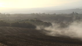 Mist rolling in. As the sun rises over the Tuscan Val d'Orcia stock video