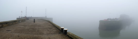 Mist or sea fret on seaside piers. Mist or sea fret on seaside piers at Bridlington, North Yorkshire Stock Photography