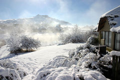 Mist from the snow. Mist risibg from the snow just after sunrise Royalty Free Stock Images