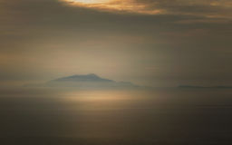 Mist surrounds the Italian islands of Isola d'Ischia and Procida Stock Image