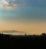 Mist in the Valley. Early morning mist rolls through the valley North of Chiang Mai Royalty Free Stock Image