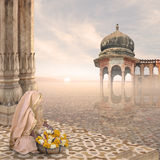 Mist. Woman doing a hindu ritual in the mist Royalty Free Stock Photo