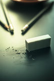 Mistake concept, Rubber Eraser on black table erase mistake back Royalty Free Stock Images