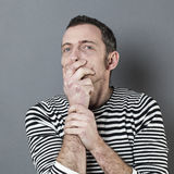 Mistake concept,stunned middle aged man,holding his mouth Stock Image