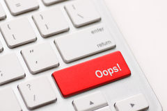 Mistake concepts, with oops message on keyboard. Oops word on key showing fail failure mistake or sorry concept Royalty Free Stock Photography