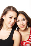 Mistaken Sisters. Two friends, who are often mistaken for sisters. Two mixed race girls, one asian and caucasian, the other african-american and caucasian royalty free stock photo