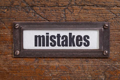 Mistakes - file cabinet label Stock Images