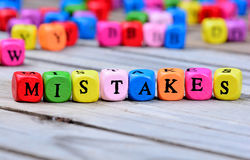 Mistakes word on table. Mistakes word on wooden table Royalty Free Stock Photos