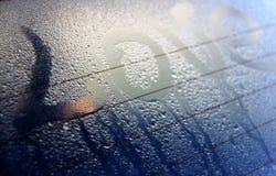 Misted au-dessus de glace avec l'inscription d'amour Photographie stock libre de droits