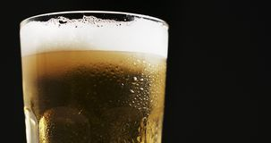 Misted glass with cold light beer stock video