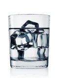 Misted glass of cold water with ice Royalty Free Stock Photography