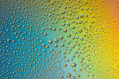 misted glass, drops closeup on rainbow colored background Stock Photo
