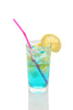 Misted glass of lemonade with lemon and blue  syrup Royalty Free Stock Photo