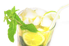 Misted glass of mojito cocktail on white. Royalty Free Stock Image