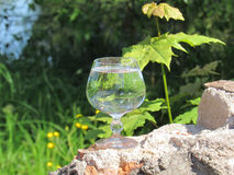 Misted glass of water. On the ruins of an ancient fortress Stock Photo