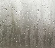 Misted glass on the window as a background Stock Photos
