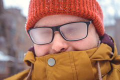 Misted glasses of man. Misted glasses of young man outside, winter day Stock Photos