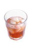 The misted over glass of whisky with an ice Stock Photography
