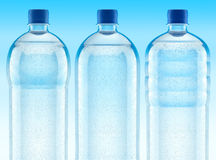 Misted plastic bottles with fresh clear water Stock Photo
