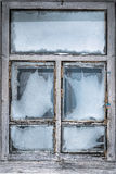 Misted snow-covered window country house Royalty Free Stock Image