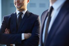 Mister Confidence. Cropped image of a confident businessman standing near his colleague on the foreground stock images