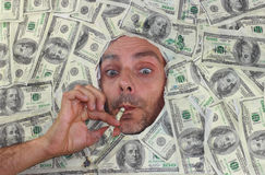 Mister Dollar smoking Stock Image