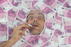 Mister Euro smoke. Mister Euro smoking a 500 euro notes Royalty Free Stock Image