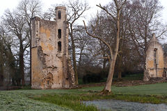 Mister Lovell Hall - The Tower. View  of the Tower at Minster Lovell Hall. The pond in the foreground. Early morning in winter Stock Images