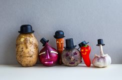 Mister potato red onion beetroot garlic pepper carrot. Old fashion style characters plants, serious faces and black hats. Gray background. Vegetarian food Royalty Free Stock Images