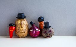 Mister potato red onion beetroot pepper carrot. Old fashion style characters plants, serious faces and black hats. Gray. Background. Vegetarian food concept Royalty Free Stock Photo