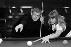 Mister training billiards and a woman Stock Image