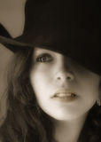 Misterious and dreamy. Young girl with a hat and a miterious and dreamy look. Soft focus