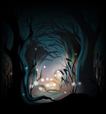 Misterious forest background. Dark mysterious forest with fireflies Stock Image
