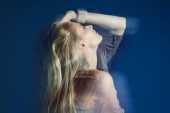 Misterious grace. Art fashion photo of a beautiful blonde young woman Royalty Free Stock Photo