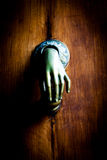Misterious Knocker. Full of mistery in this detail of ancient knocker Stock Images