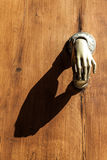 Misterious Knocker. Full of mistery in this detail of ancient knocker Royalty Free Stock Image