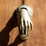 Misterious Knocker. Full of mistery in this detail of ancient knocker Stock Photos