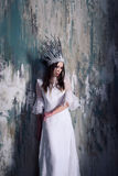 Misterious woman in white crown Royalty Free Stock Image