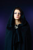 Misteriouse woman in black hood Stock Image
