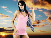 Mistery woman. Cute girl with sun glasses wearing a red beach dress and blue foulard with white dot Stock Image