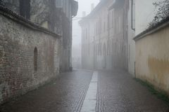 The mistic street in the city, foggy day in Italy.  Royalty Free Stock Image